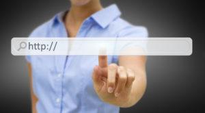 Businesswoman clicking on tactile interface web address bar